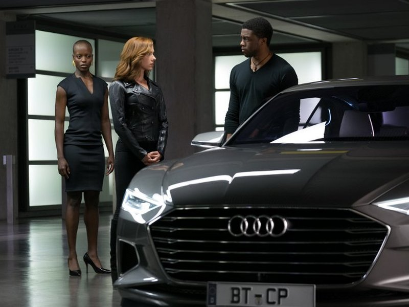 An Audi is shown with a portion of the cast of <i>Captain America: Civil War</i>