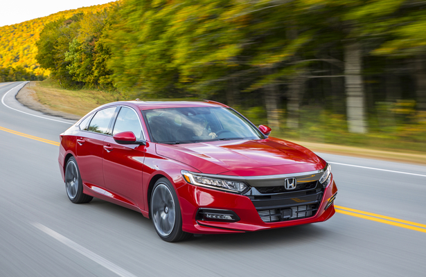2018 Honda Accord in red driving fast on a curvy road