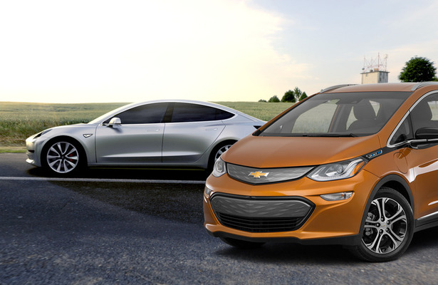 Chevrolet Bolt and a Tesla Model 3 next to each other