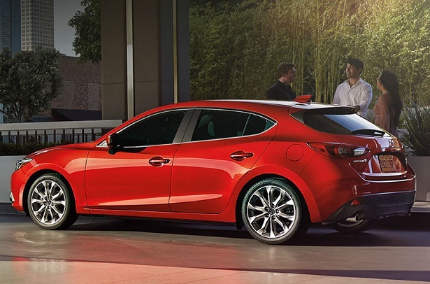 2018 mazda3 red three people talking