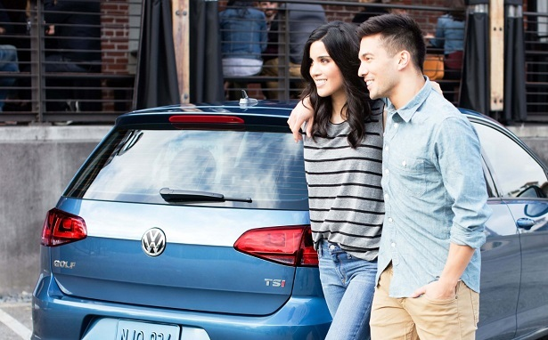 2018 volkswagen golf TSI blue rear couple smiling
