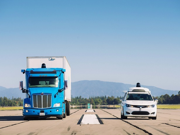 waymo minivan and truck