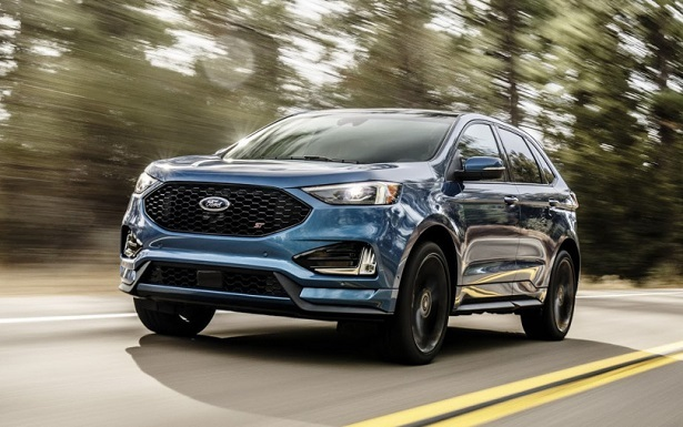 2018 ford edge blue driving fast