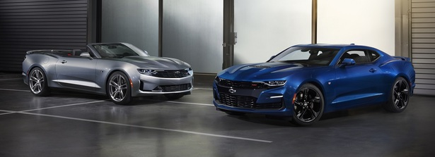 two 2019 chevrolet Camaros parked next to each other
