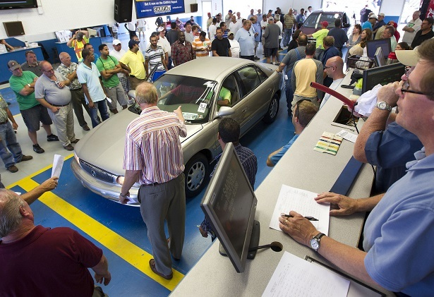 crowded car auction
