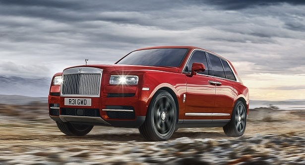 rolls-royce cullinan red driving front 34