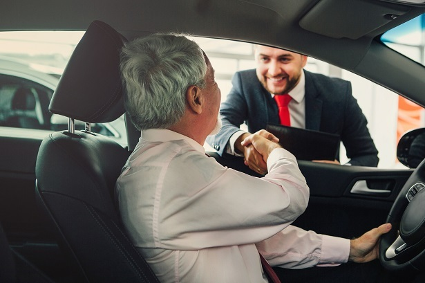 car buyer shaking hands with salesperson