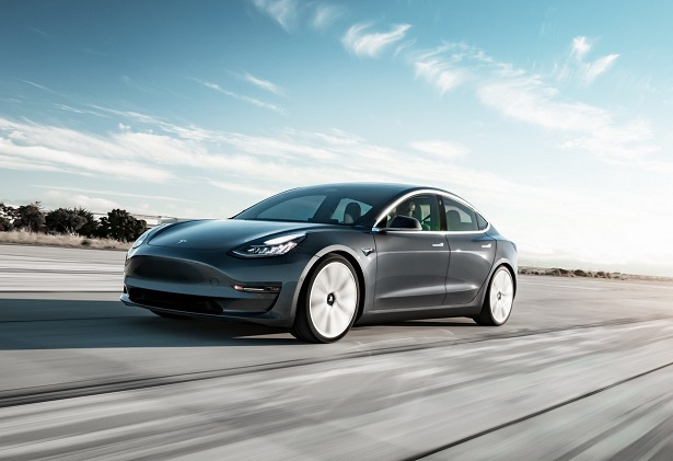 tesla model 3 grey speeding