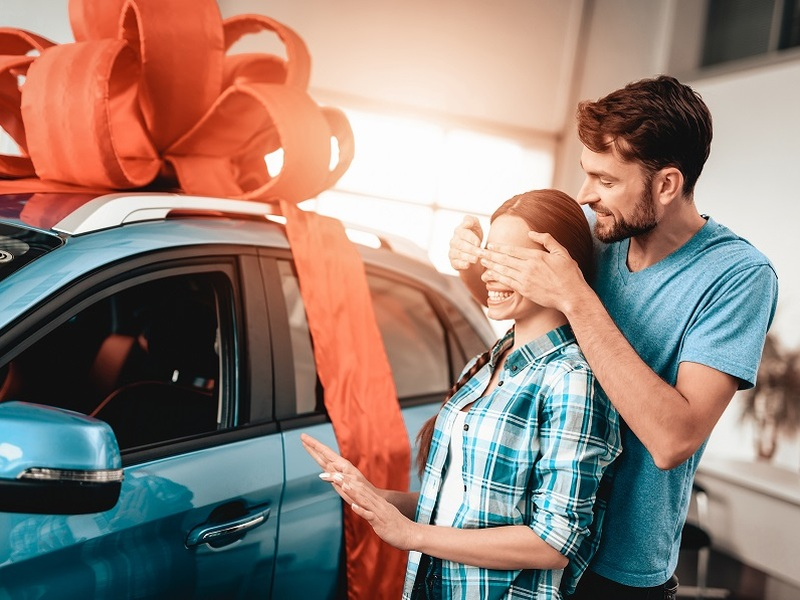 Unless you pay for the car outright, you should reconsider keeping it a surprise.