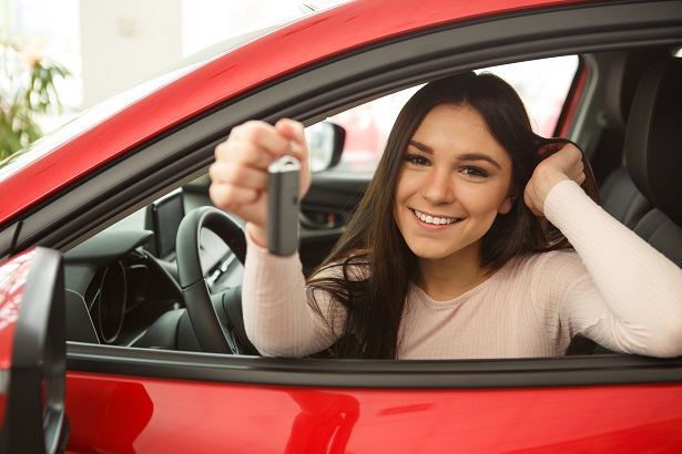 Young driver paying off auto loan