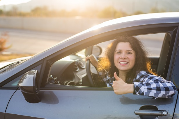 happy car shopper after getting a car loan